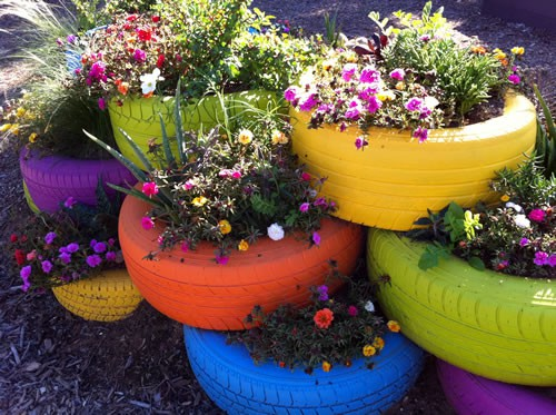 Rammed earth tyres ingle pingle for Car tire flower planter