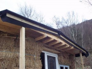 The roof here with the drip edge installed. The membrane needs trimming, and a gutter.