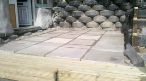 The decking provides a step up around the tyre edge of the patio